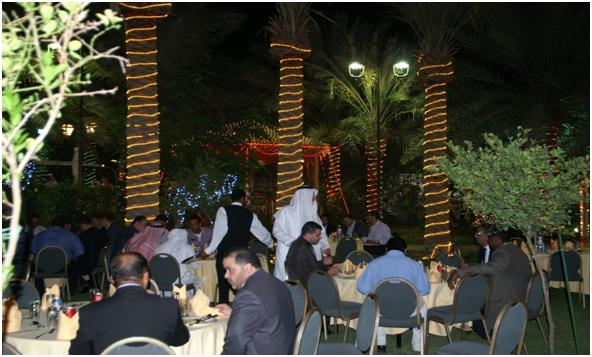 Shown here are some  employees  chatting with  each other while  enjoying the warmth and cozy atmosphere  on  the beautiful garden  located just at the back of Sheikh Ali?s grandiose palace.