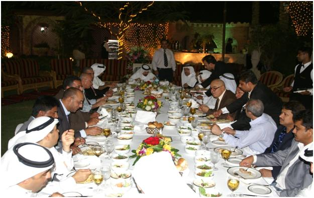 A SUMPTOUS DINNER: Founder and Chairman of ETE Group, Sheikh Ali Bu-Khamsin (  far end table  ) , alongside  with the top management officials have heartily shared the sumptuous dinner.